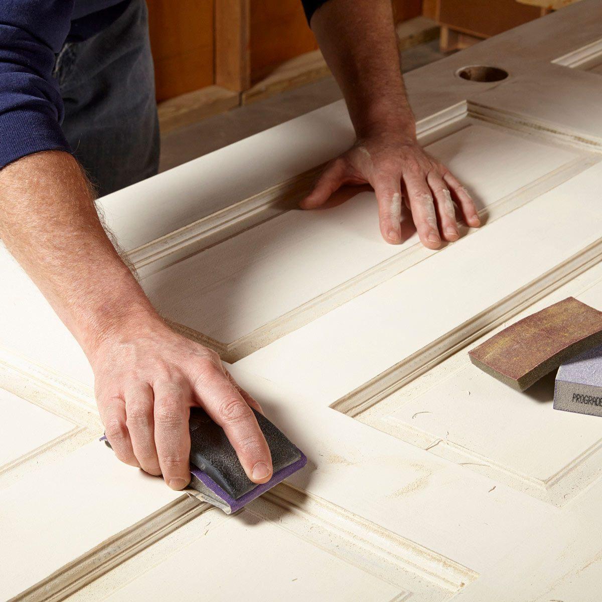 painting a door prep sand the door