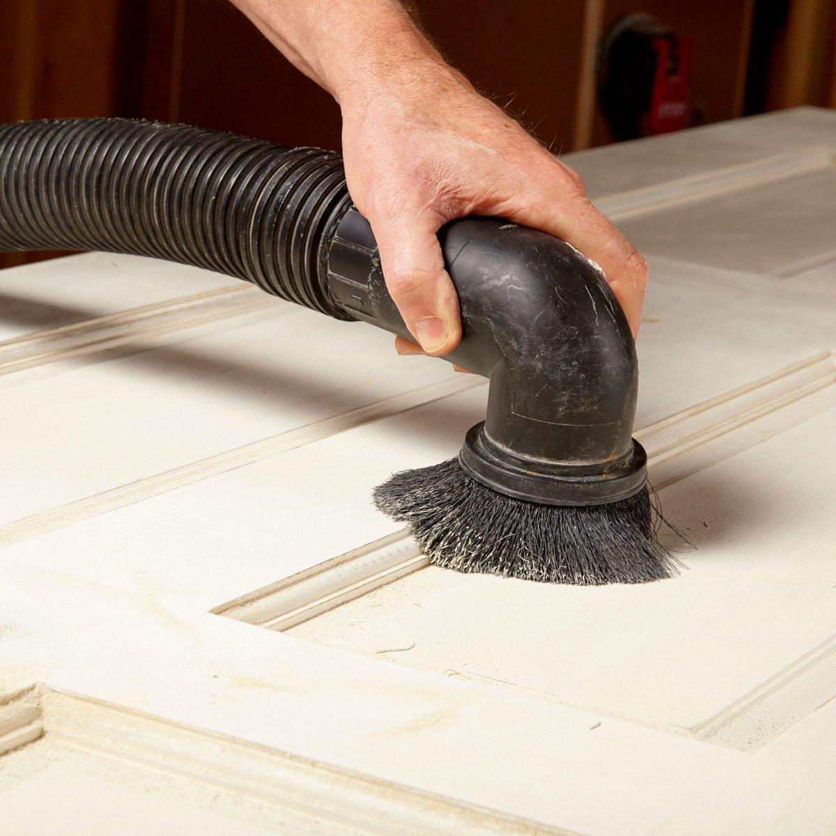 Remove the sanding dust from door