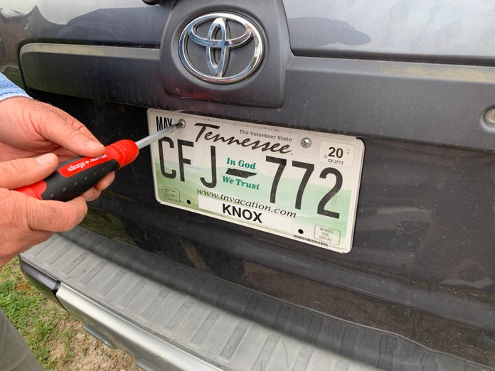Cleaning a license plate
