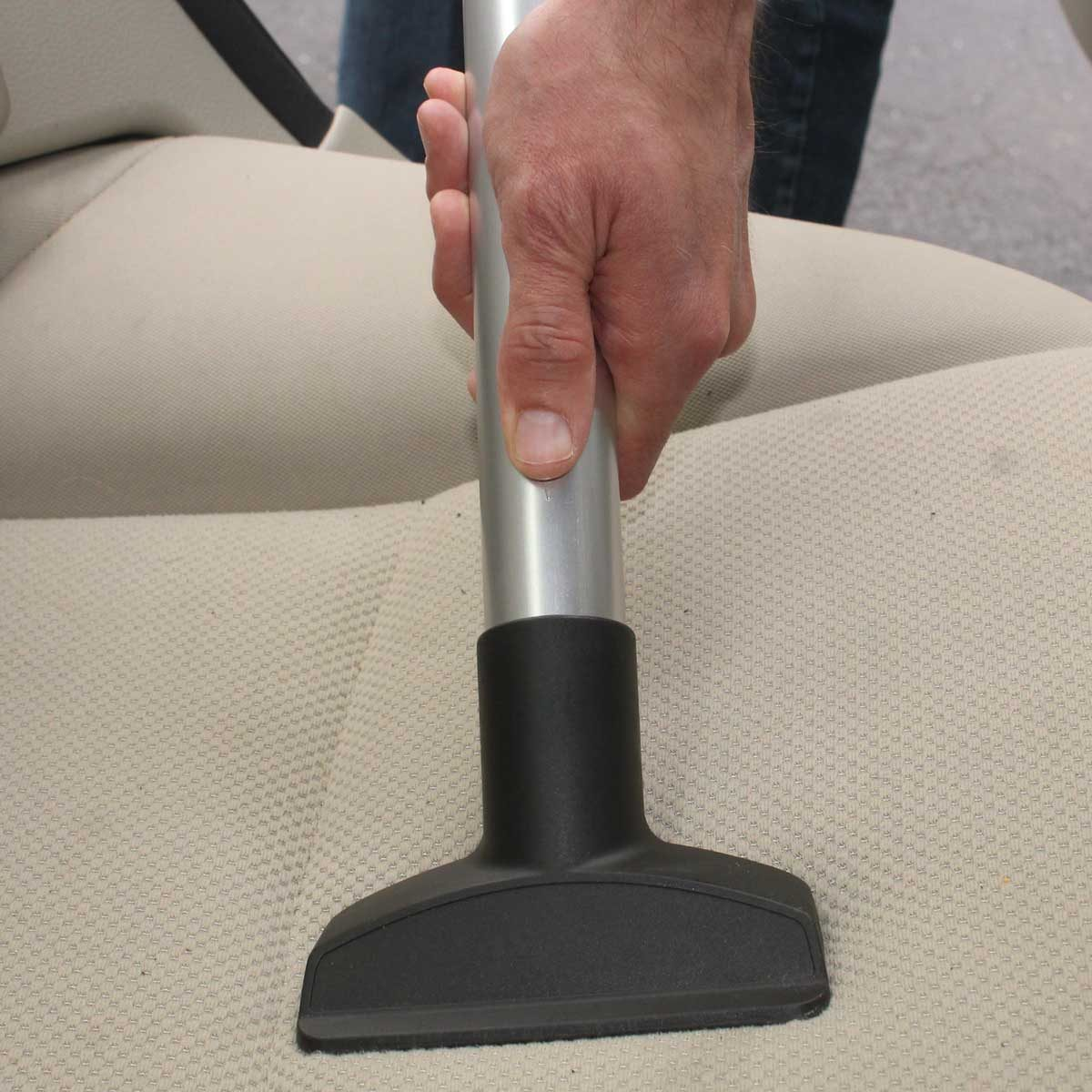 Vacuuming a cloth car seat