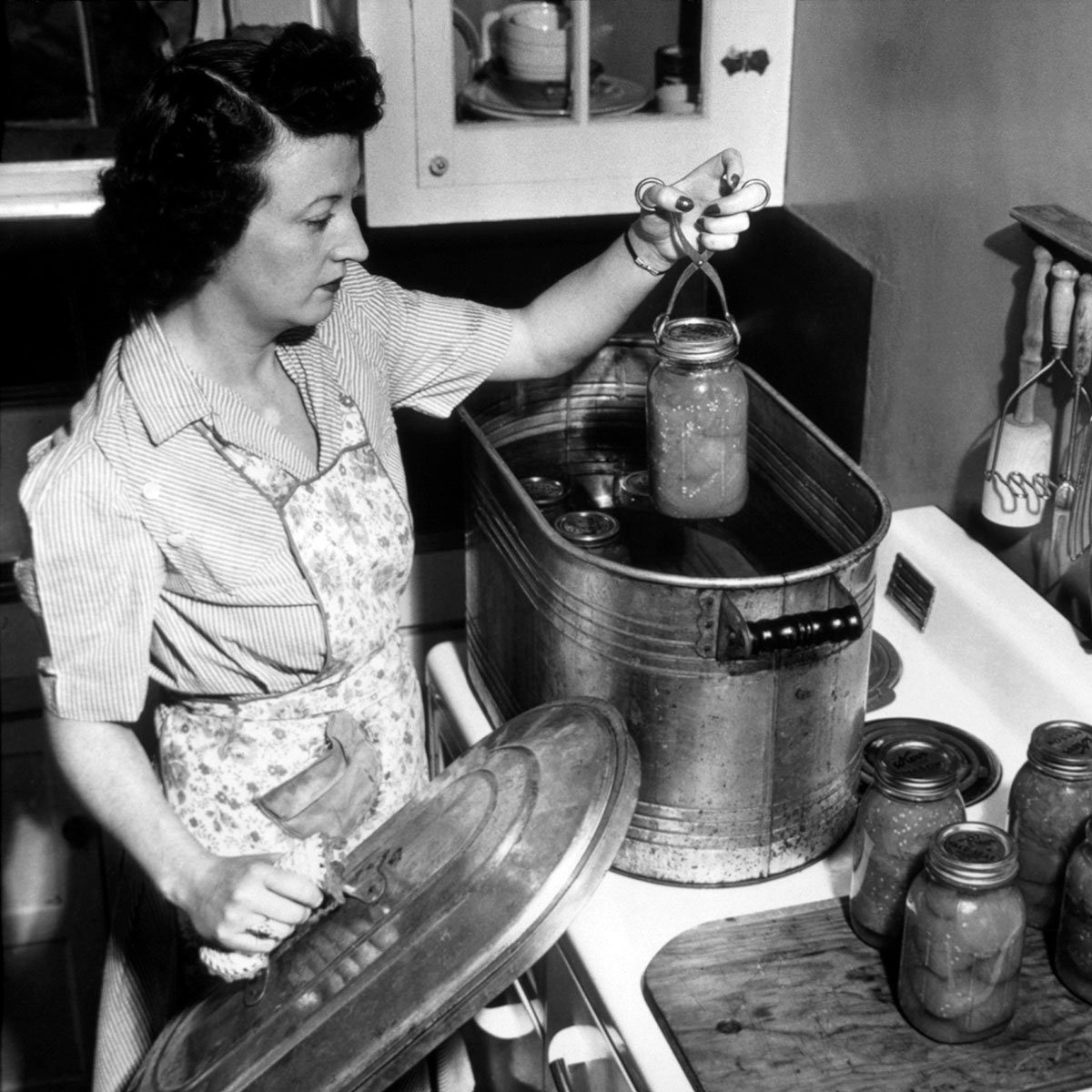 Housewife Preserving Tomatoes from Her Victory Garden, U.S. Dept. of Agriculture Photo, 1944. (Photo by: Universal History Archive/Universal Images Group via Getty Images)