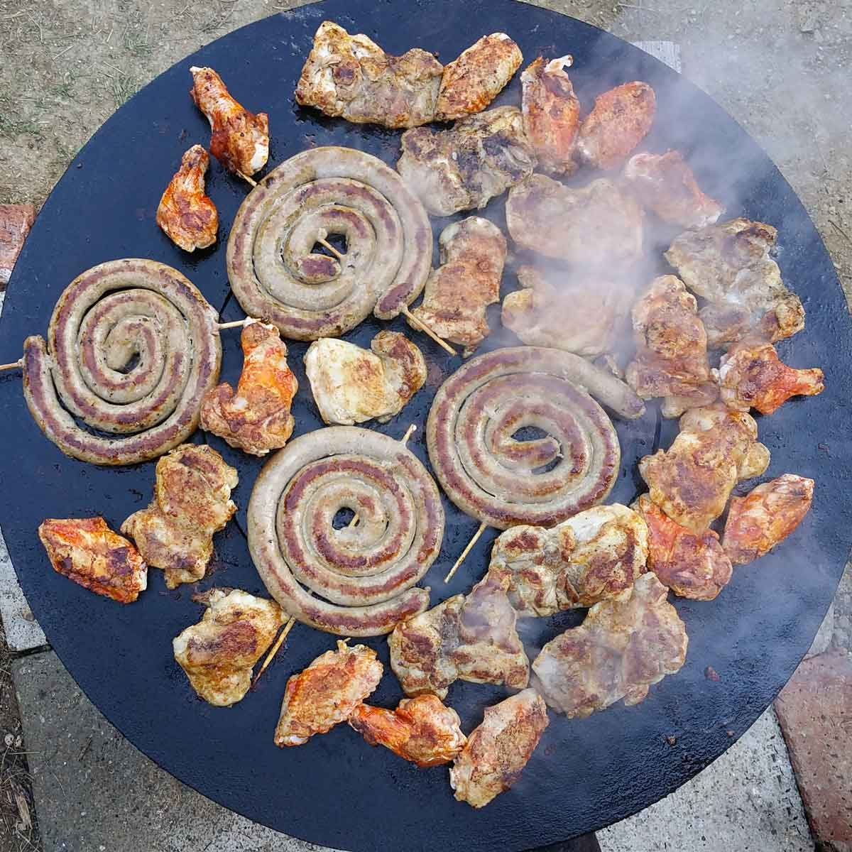 Meat cooking on a discada