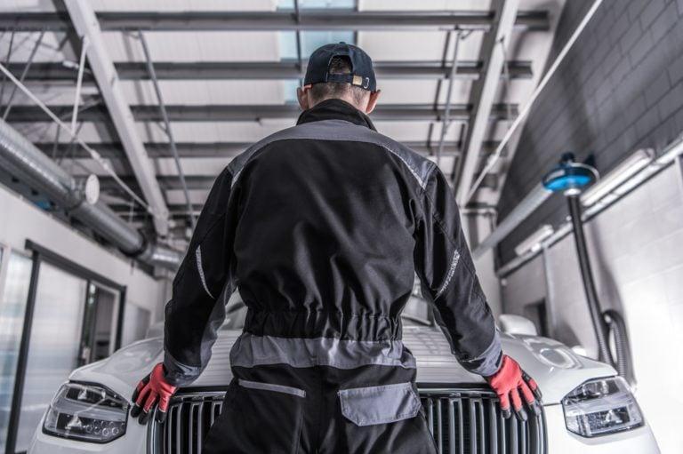 Car Mechanic Challenge. Caucasian Auto Service Worker Preparing For Challenging Work To Fix Broken Vehicle.