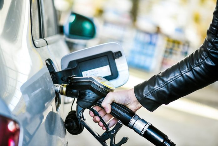 Refueling car at gas station. Filling fuel.