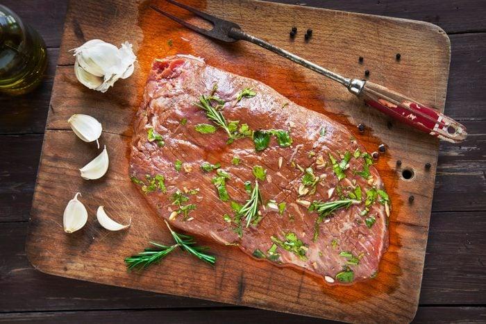 Uncooked Marinated Flank Steak