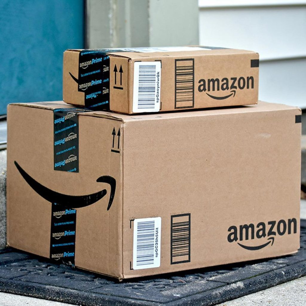 Odenton, United States of America - February 4, 2016: Amazon packages delivered to the front door of a home. Amazon is the largest internet based retailer in the United States.