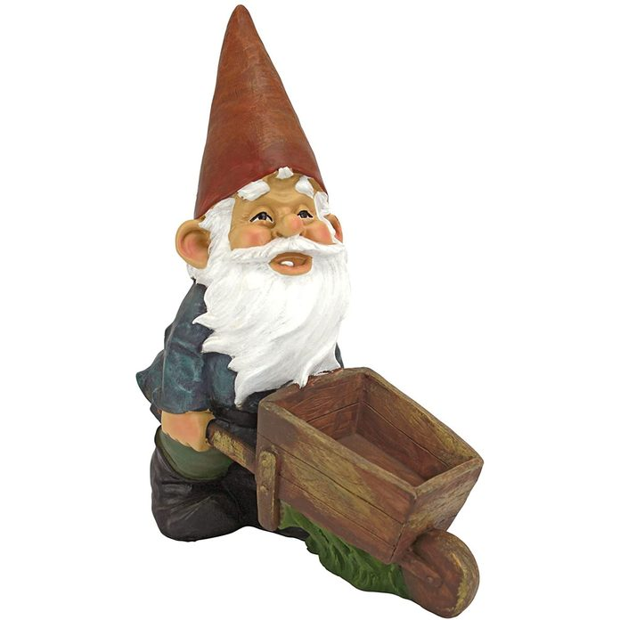 Garden gnome with a wheelbarrow