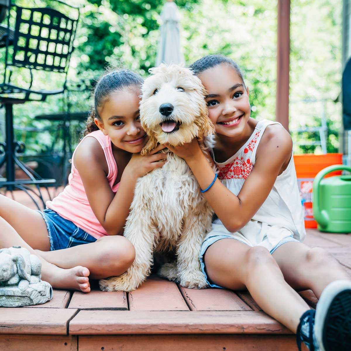 Young sisters with their dog
