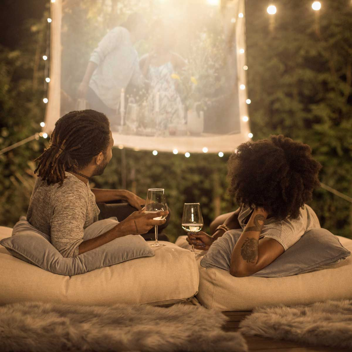 Couple watching an outdoor projector