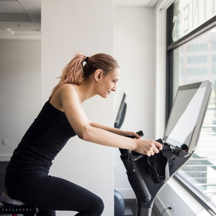 Woman using a stationary bike