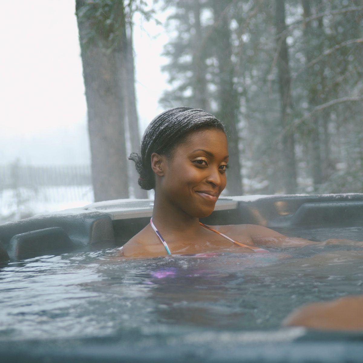 Woman sitting in a hot tub