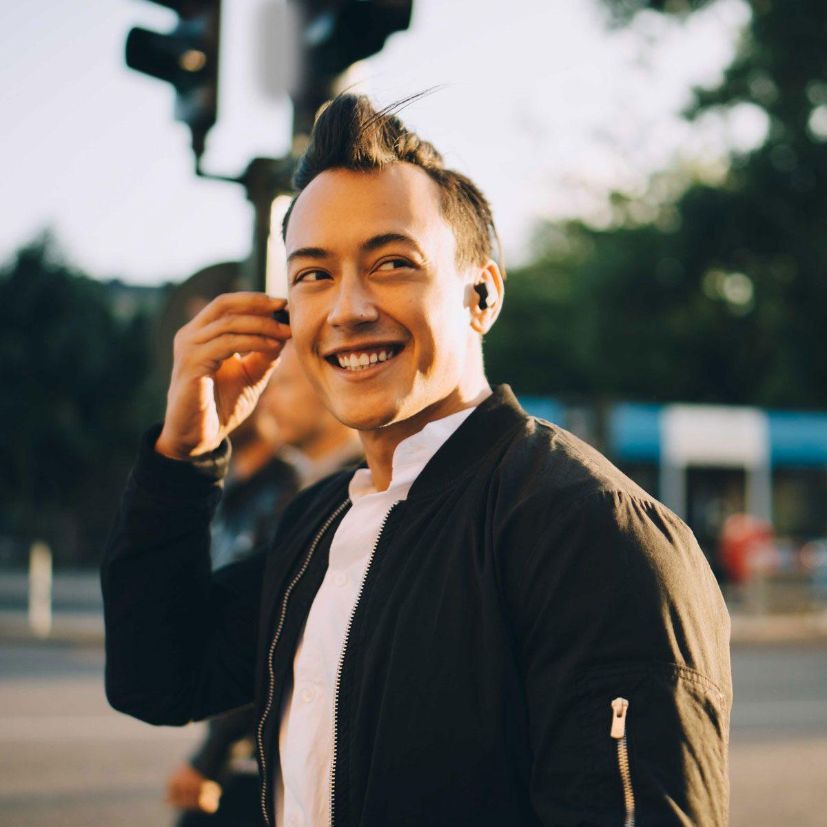 Man wearing wireless headphones
