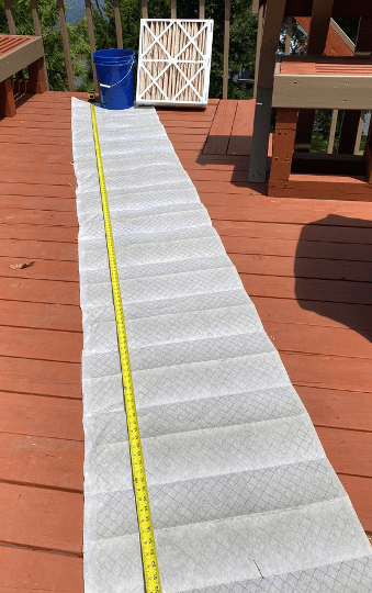 The filter media of a 21 x 23.5 x 5-inch pleated filter stretched out to its full length.