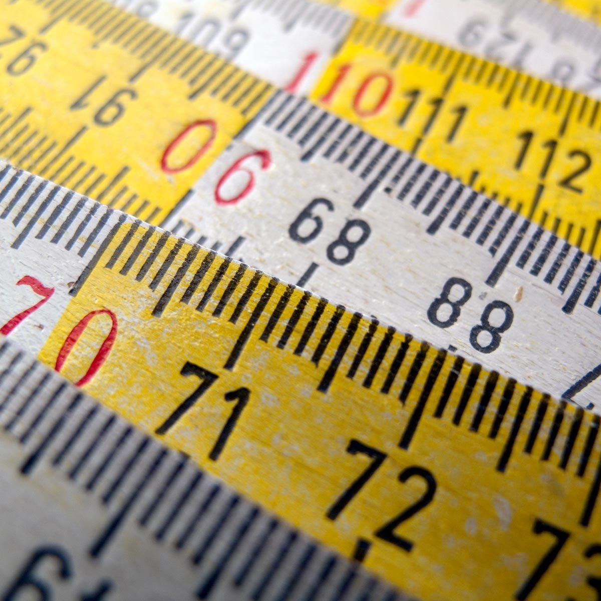 wooden white and yellow ruler metric system