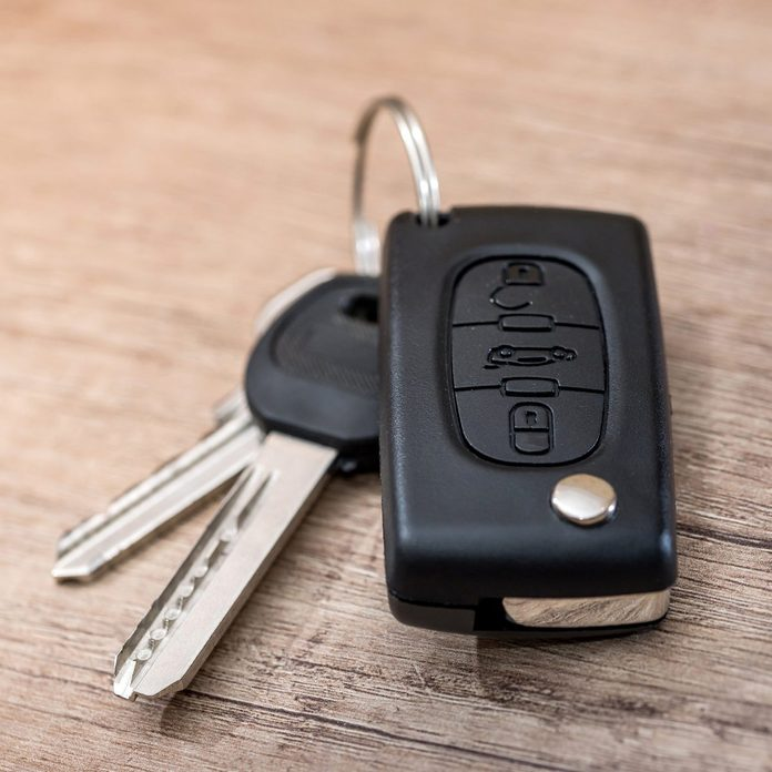 black car key on wooden desk with copy space.