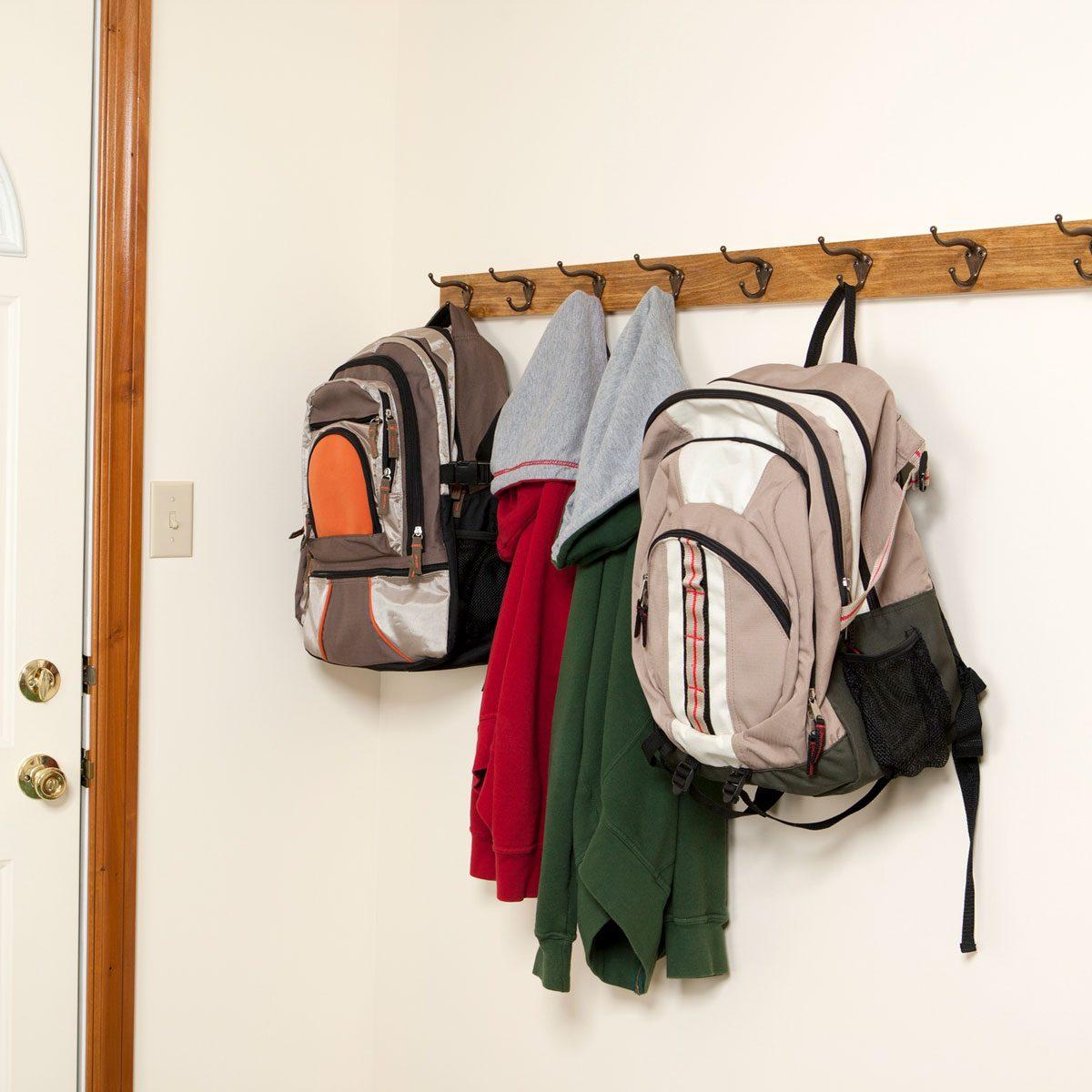 Backpacks hanging from hooks