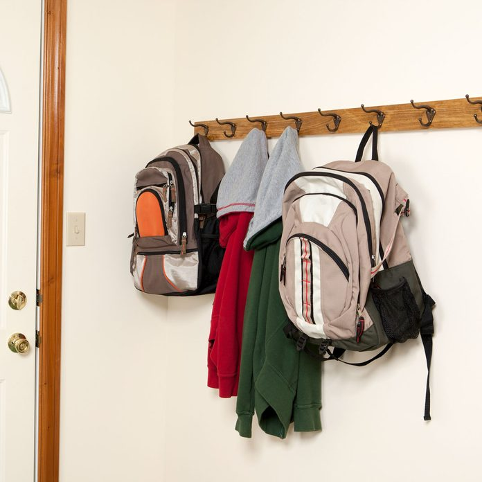 Backpacks hanging from hooks