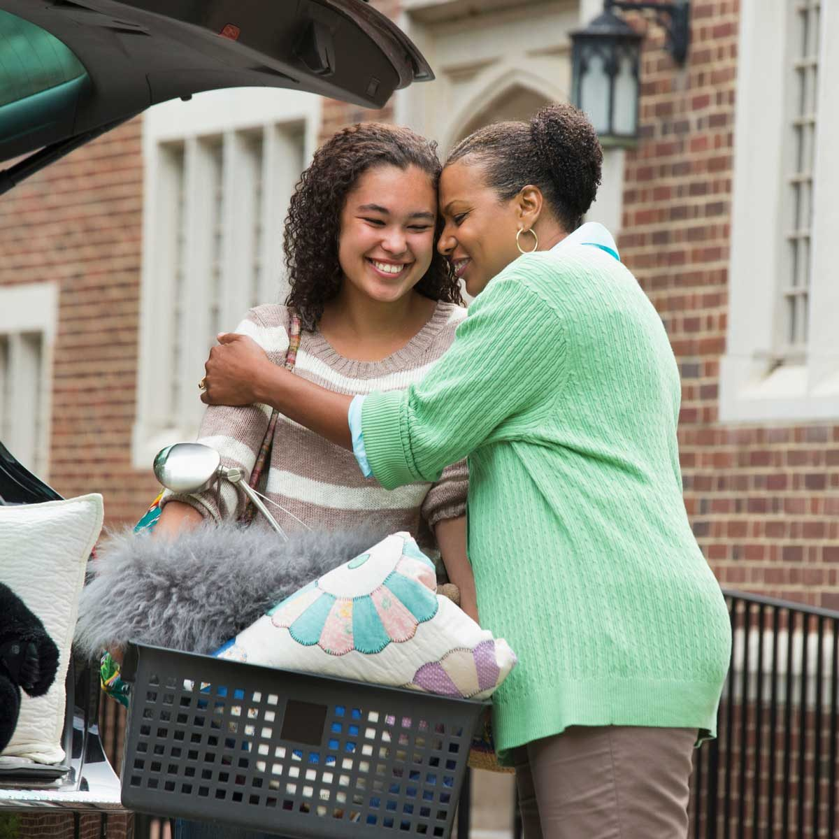 Mother seeing daughter off to college