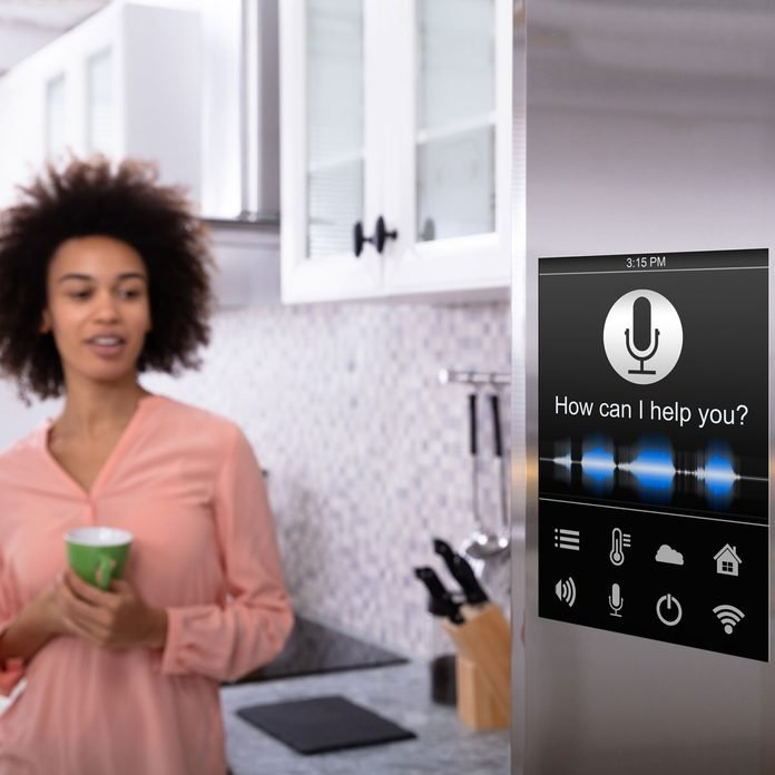 Woman standing by a smart fridge