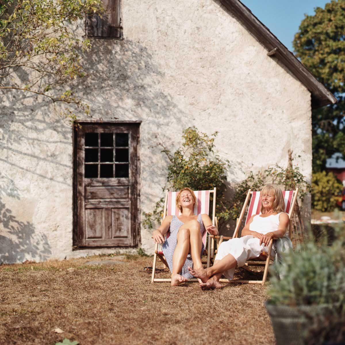 Two women relaxing in folding chairs