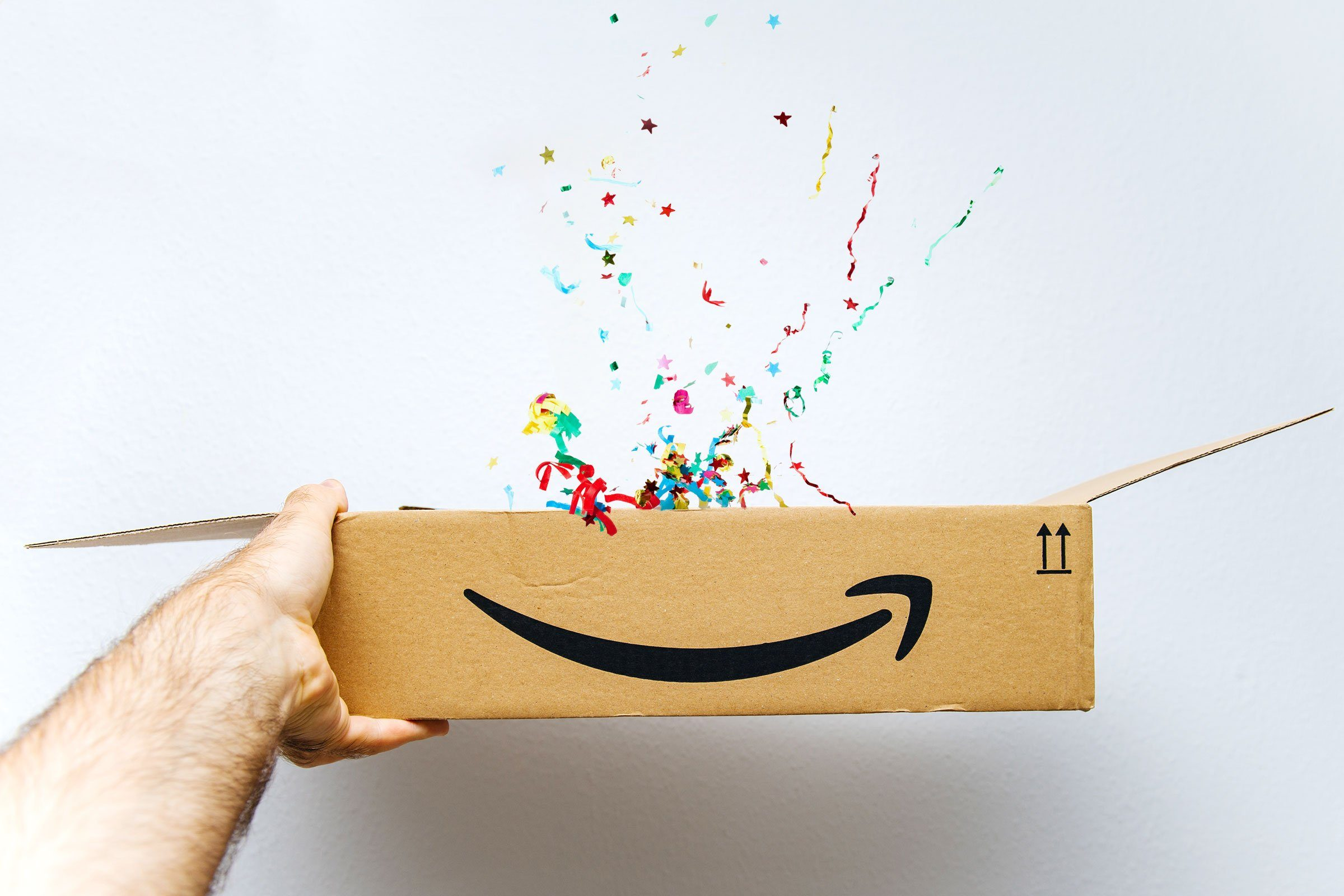 confetti popping out of an amazon box