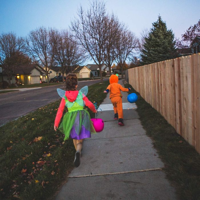 Little boy and Little girl trick or treating