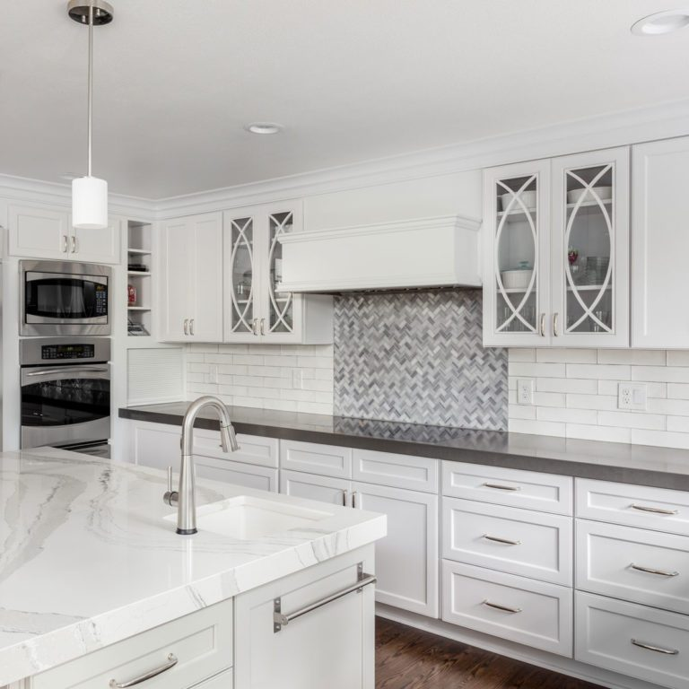 Kitchen with two tile backsplashes