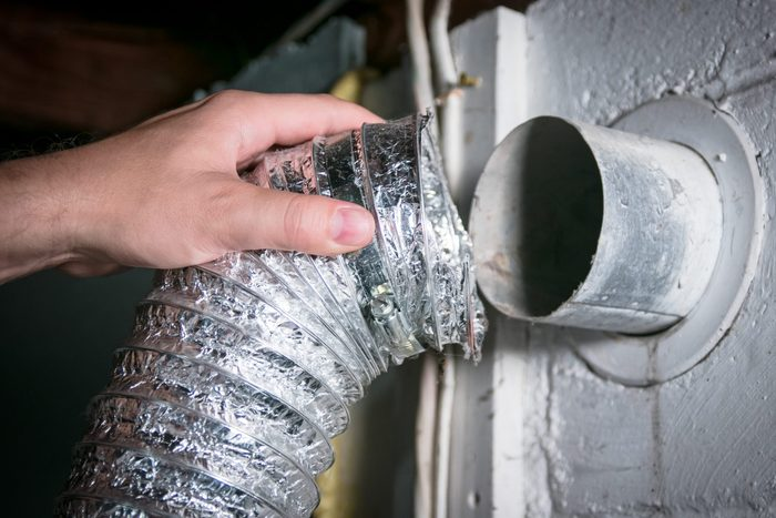 Flexible aluminum dryer vent hose, removed for cleaning/repair/maintenance