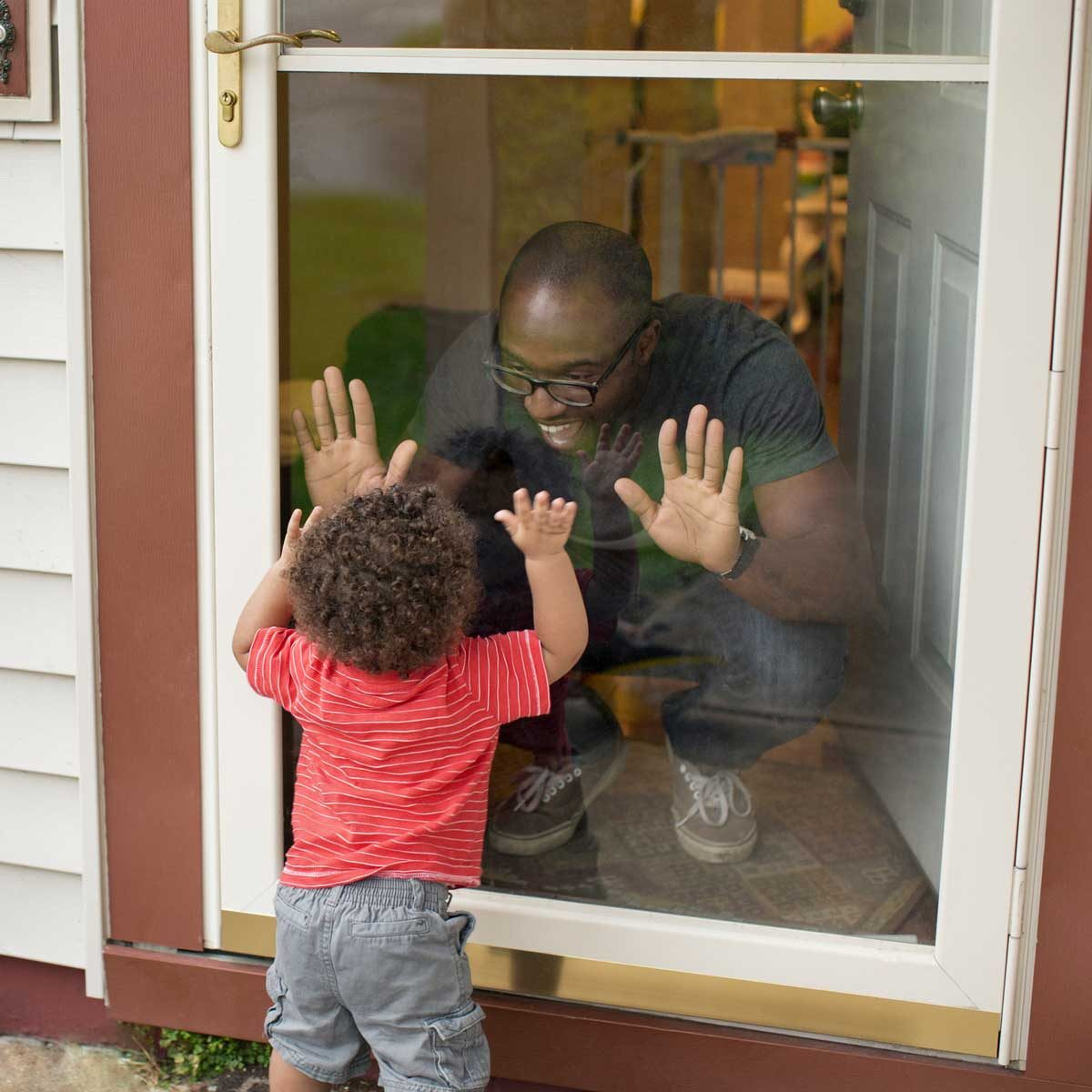 Family by a storm door