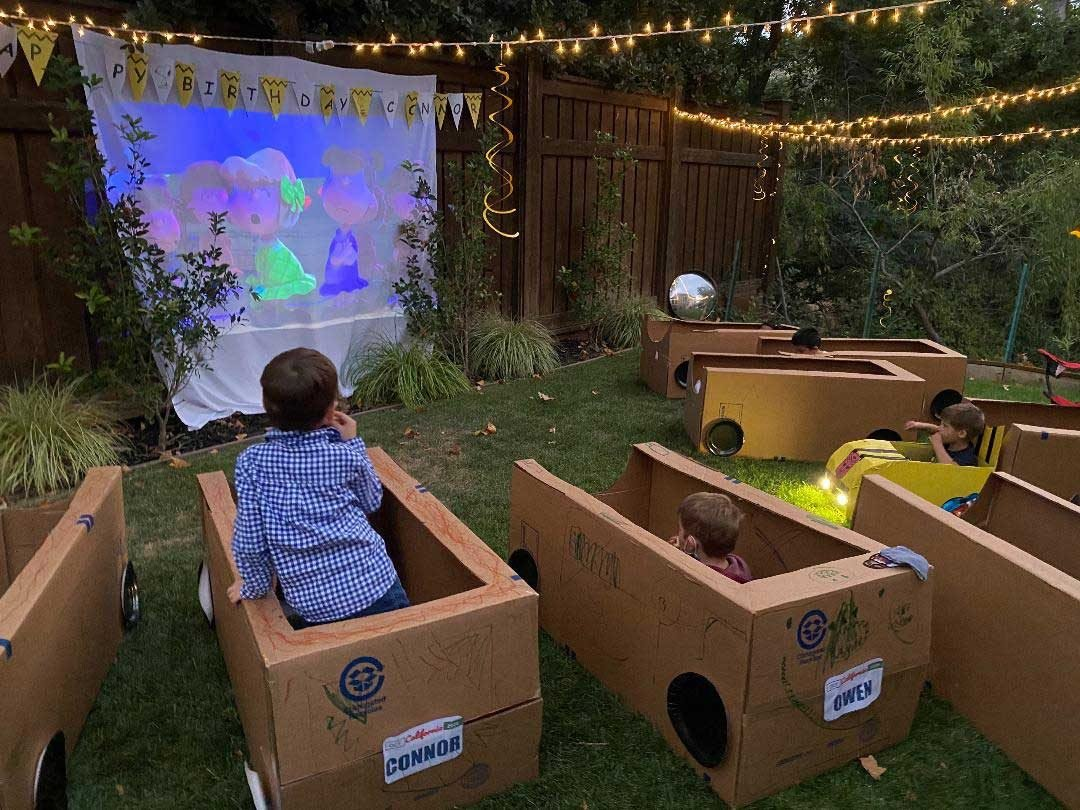 Children in boxes watching a movie