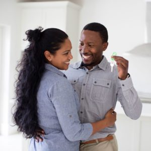 Young Couple Purchasing New Home