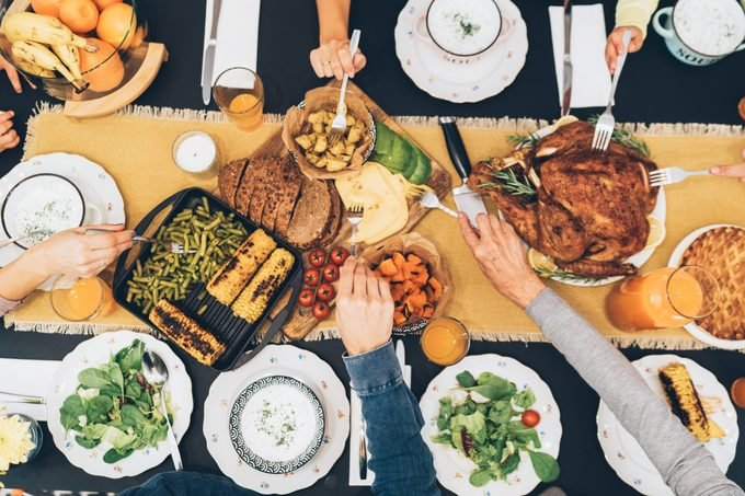 Overhead view of table during thanksgiving dinner friendsgiving