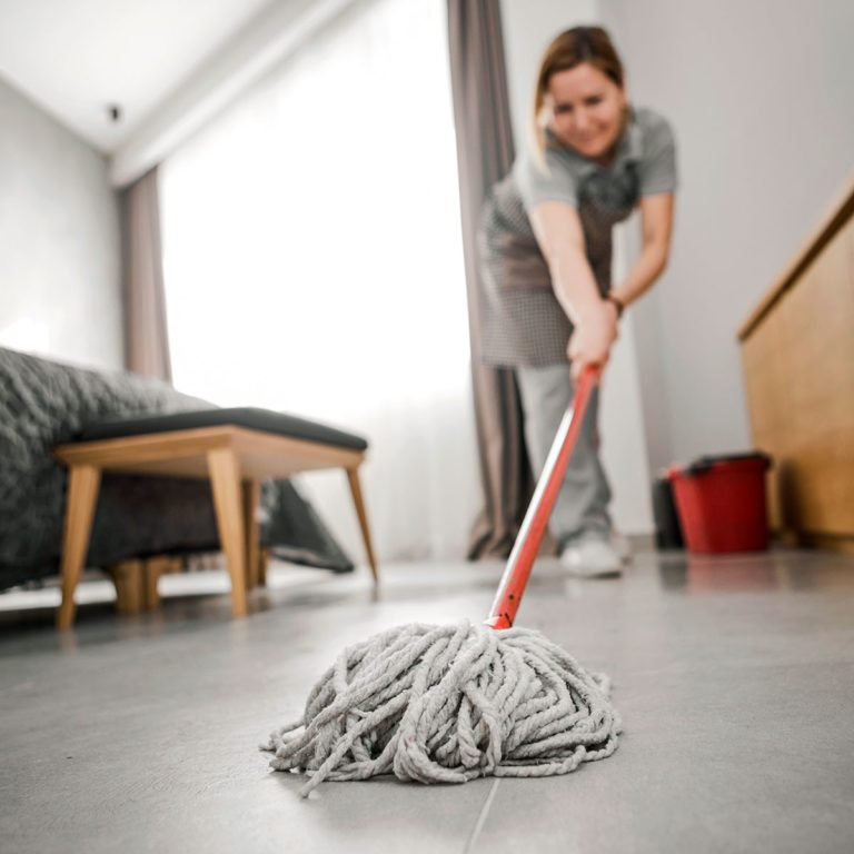cleaning home with mop