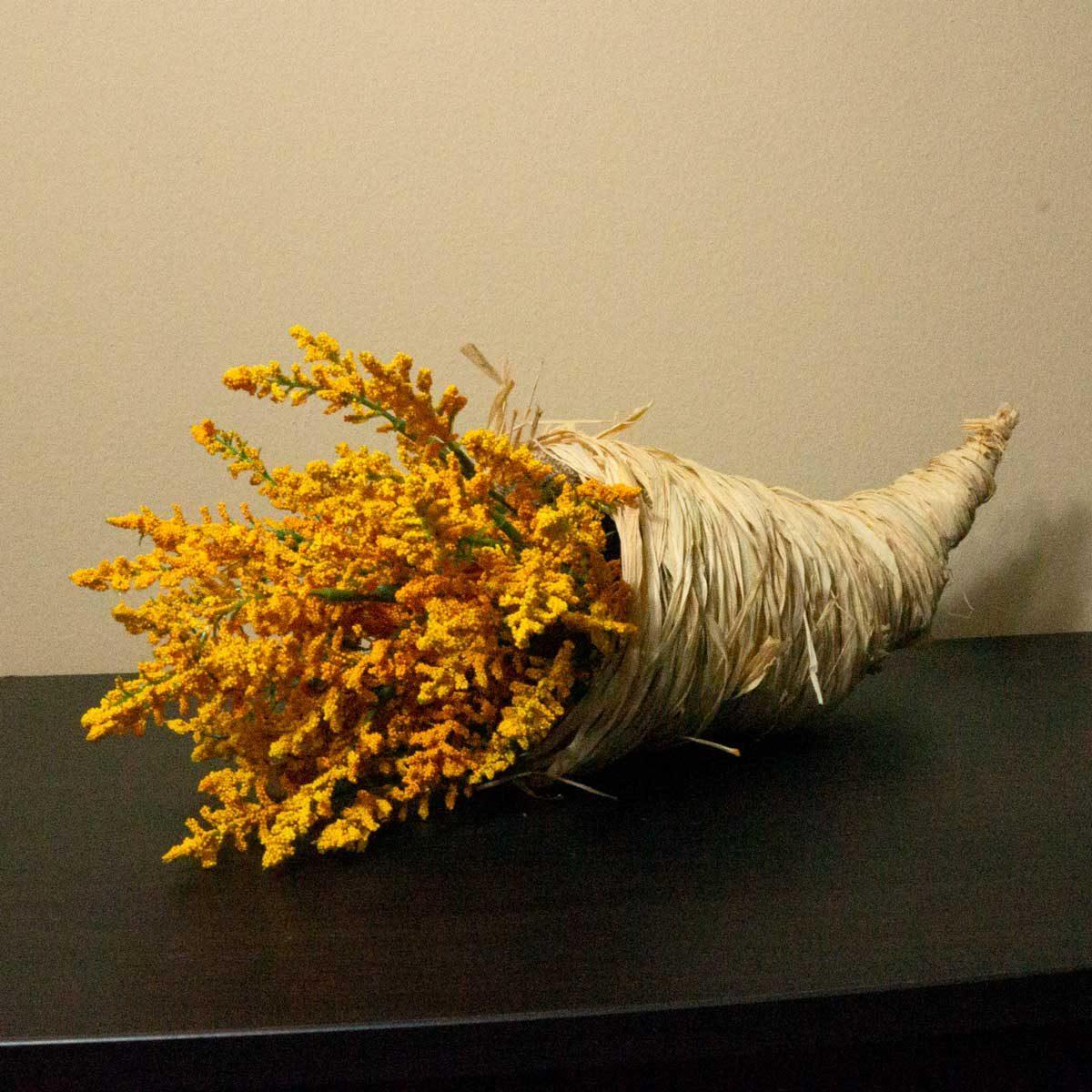 DIY cornucopia with yellow flowers