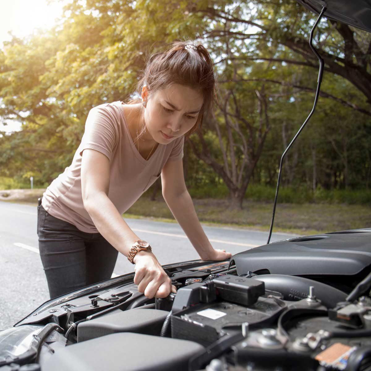 Woman examining car