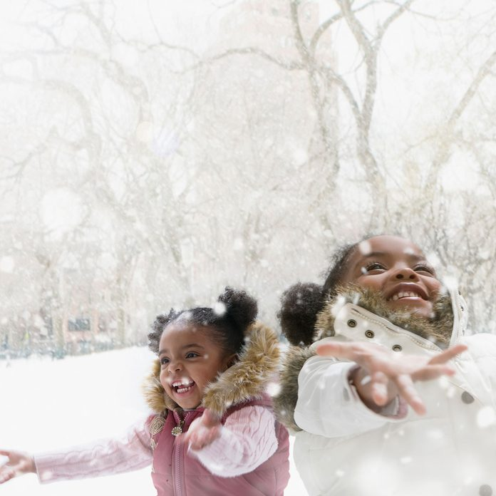 Sisters catching snowflakes