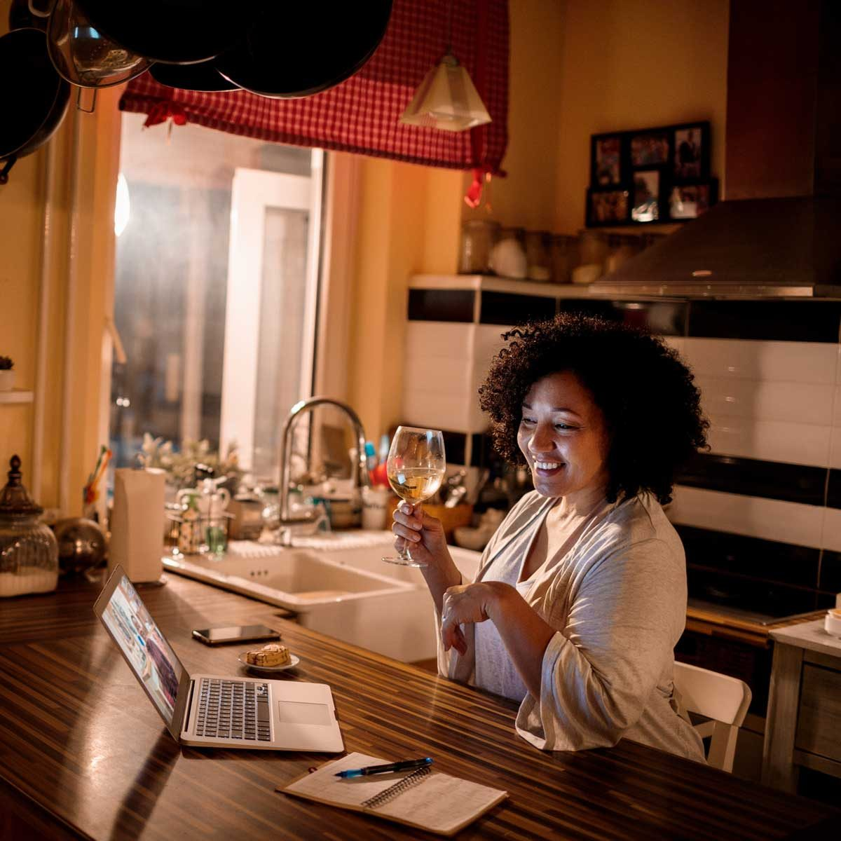 Woman having a glass of wine for virtual Friendsgiving