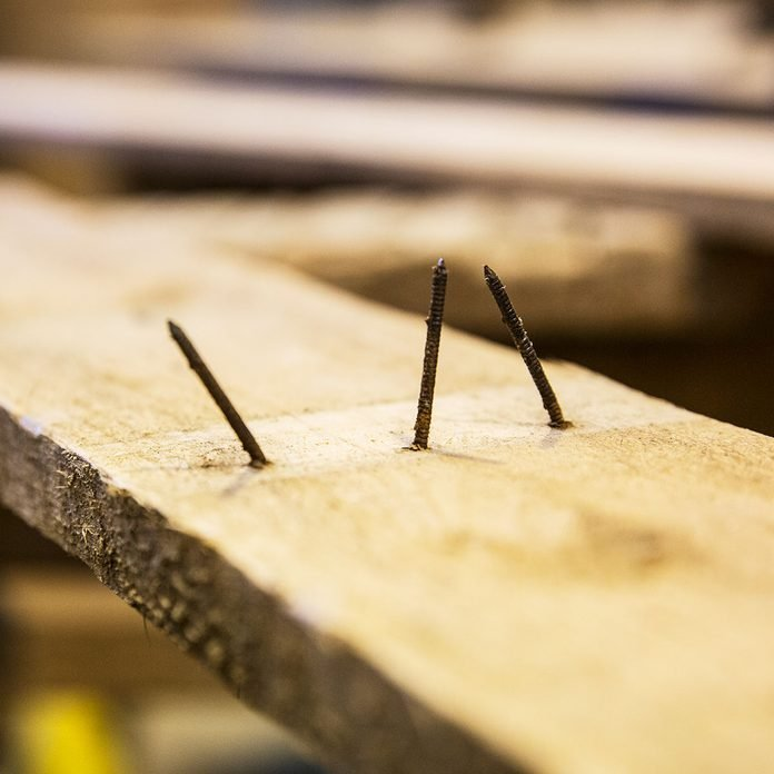 nails coming out of wood