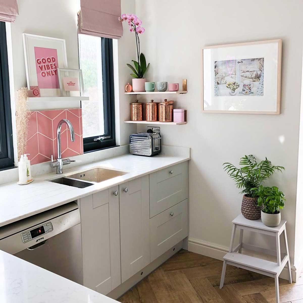 Kitchen with pink artwork