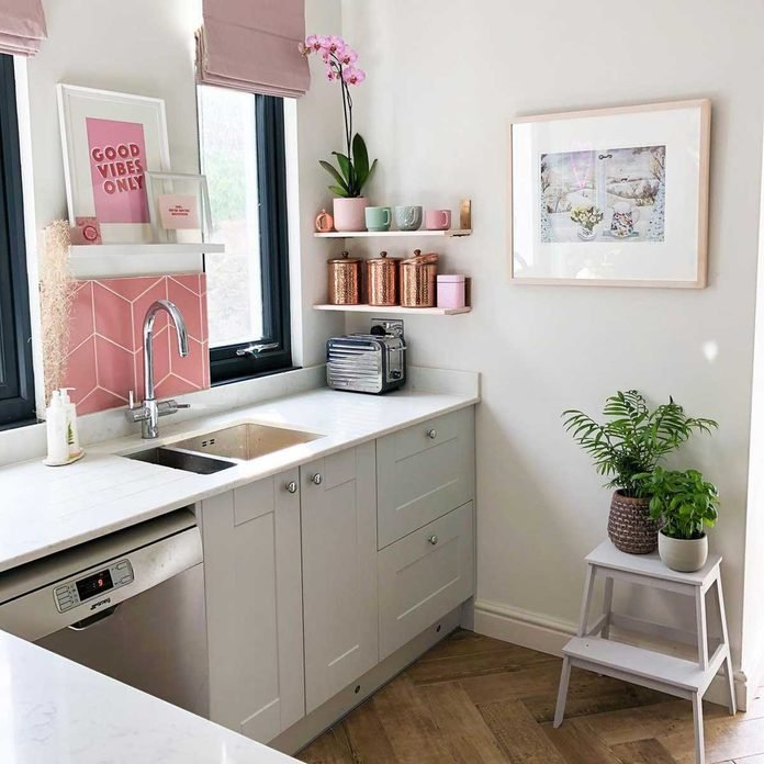 Kitchen with pink artwork