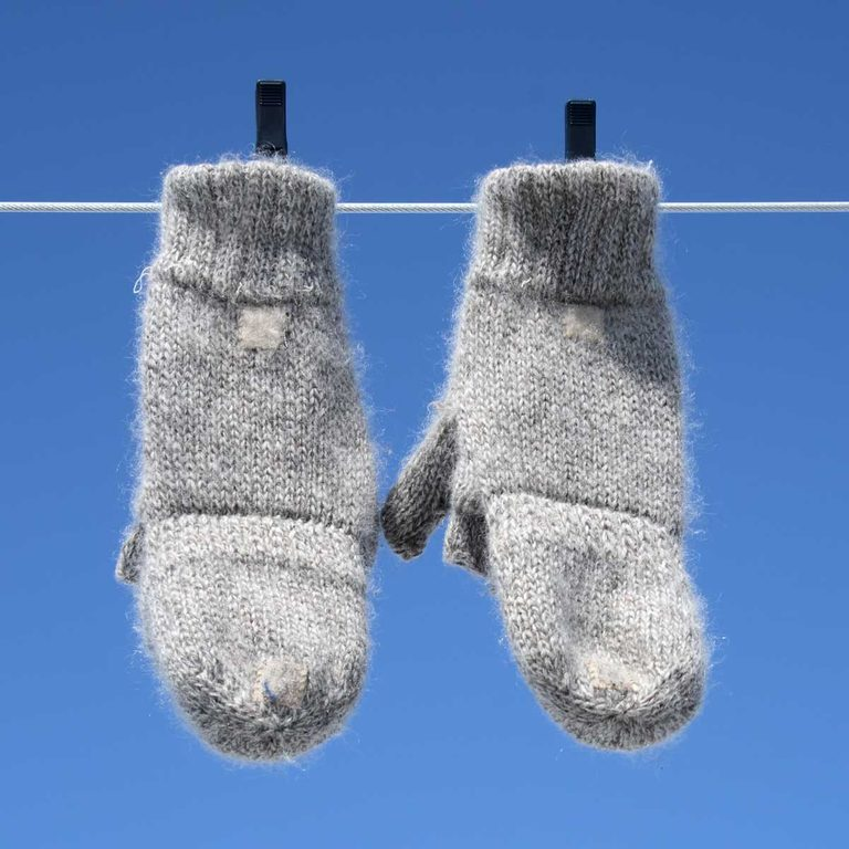 Mittens hanging on a clothesline