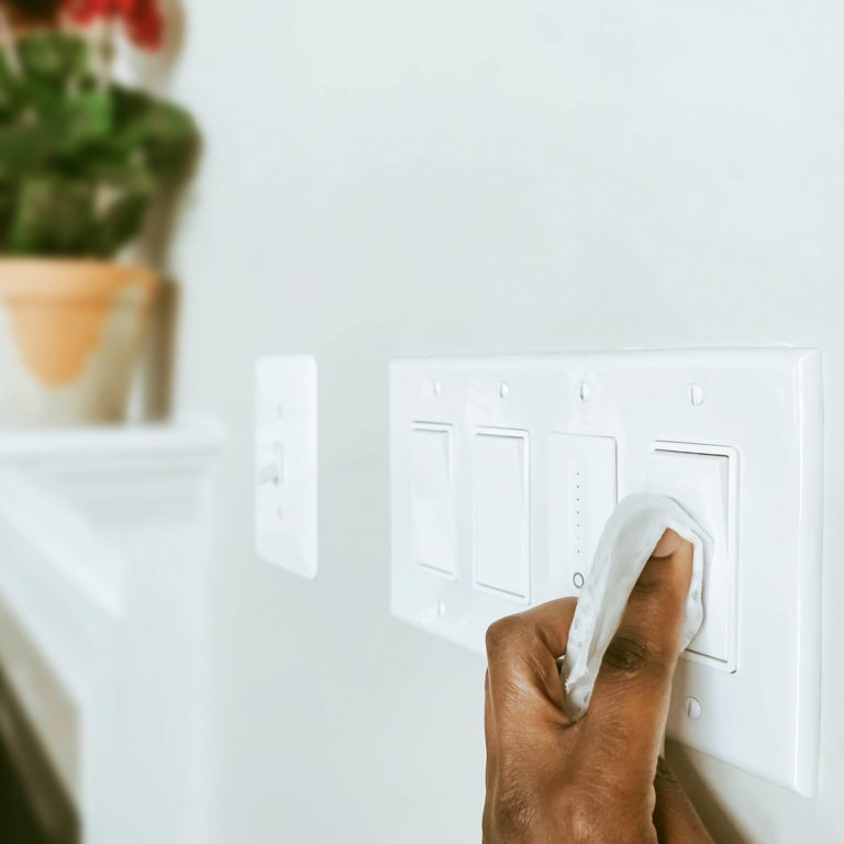 Cleans Light Switches Using Disinfectant Wipe Gettyimages 1211886751
