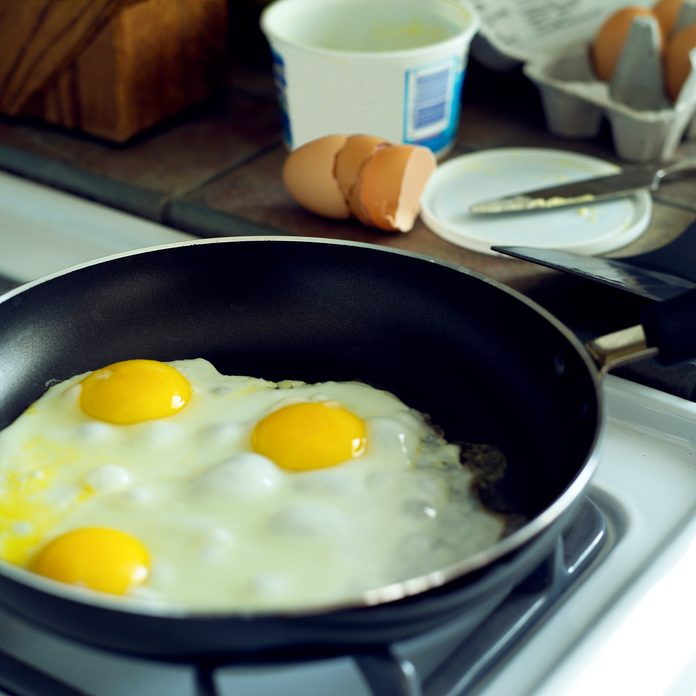 Non-stick frying pan with sunny side up eggs Gettyimages 522900182