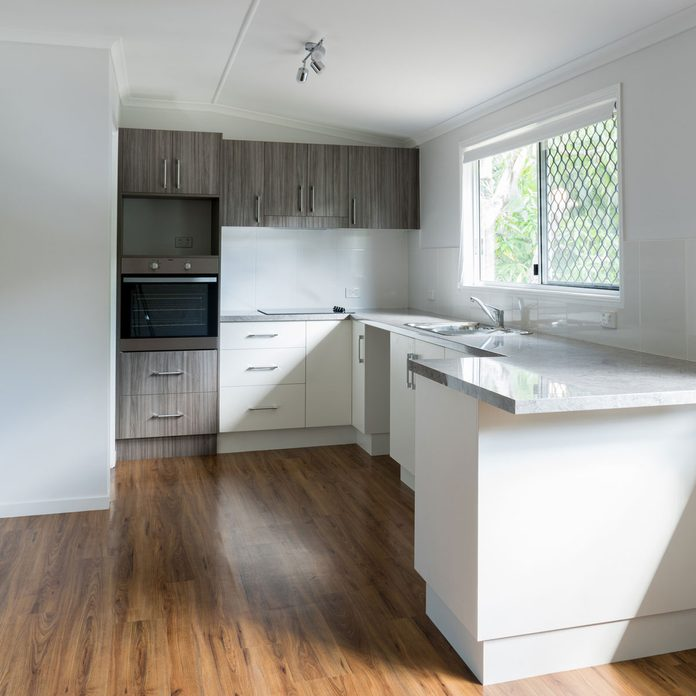 Kitchen with semi-transparent gray stained cabinets