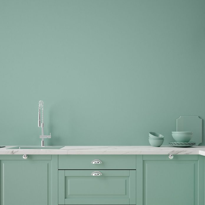 Matching green cabinets and walls