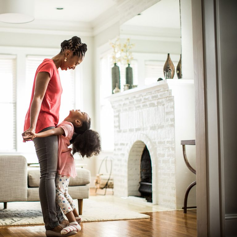 Mother and Daughter near Fireplace Gettyimages 638932745