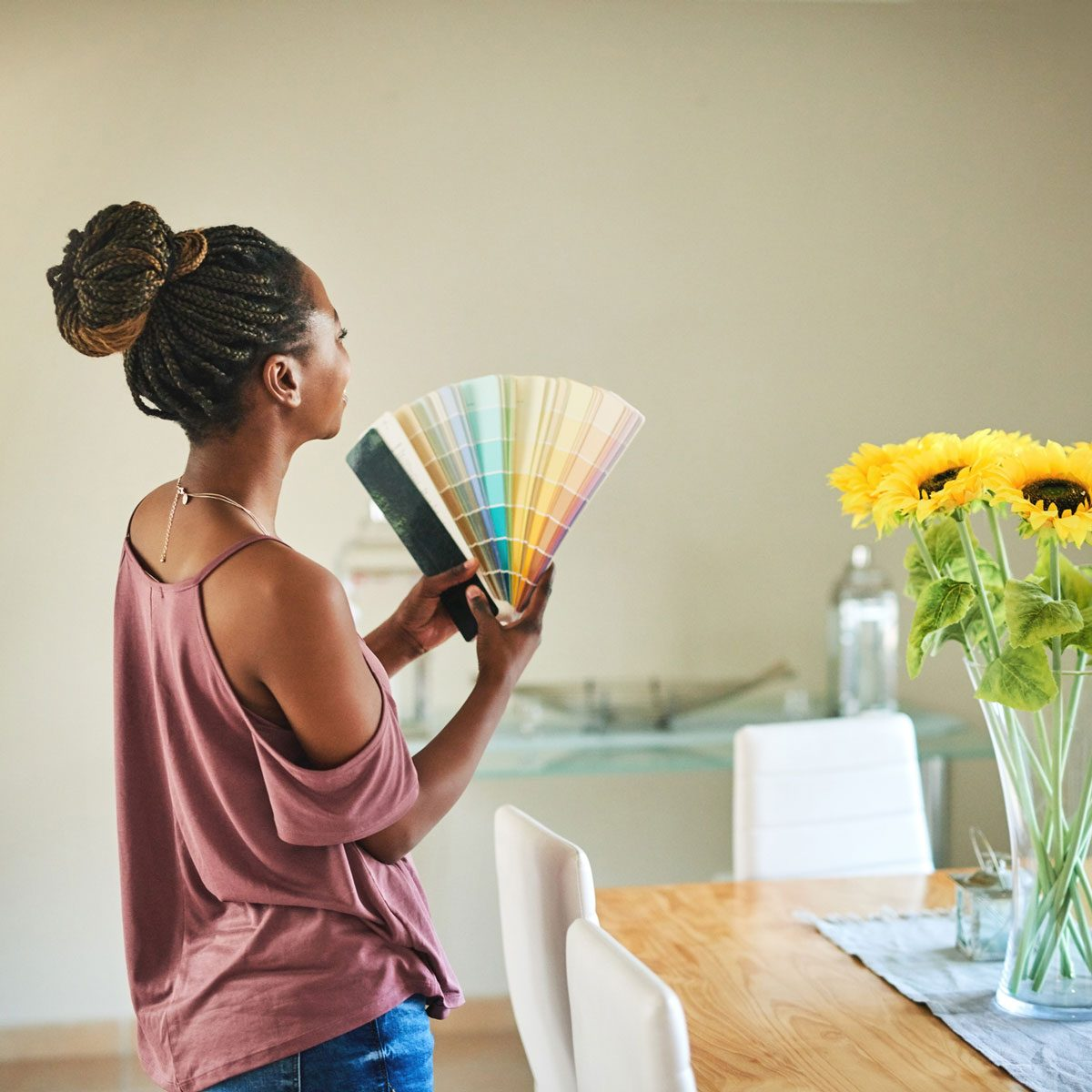 Woman choosing paint colors for redecorating