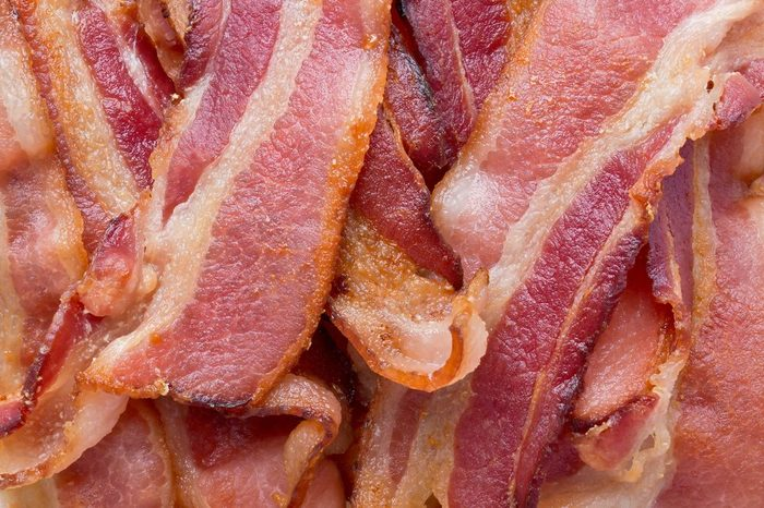Background texture of fried bacon strips.