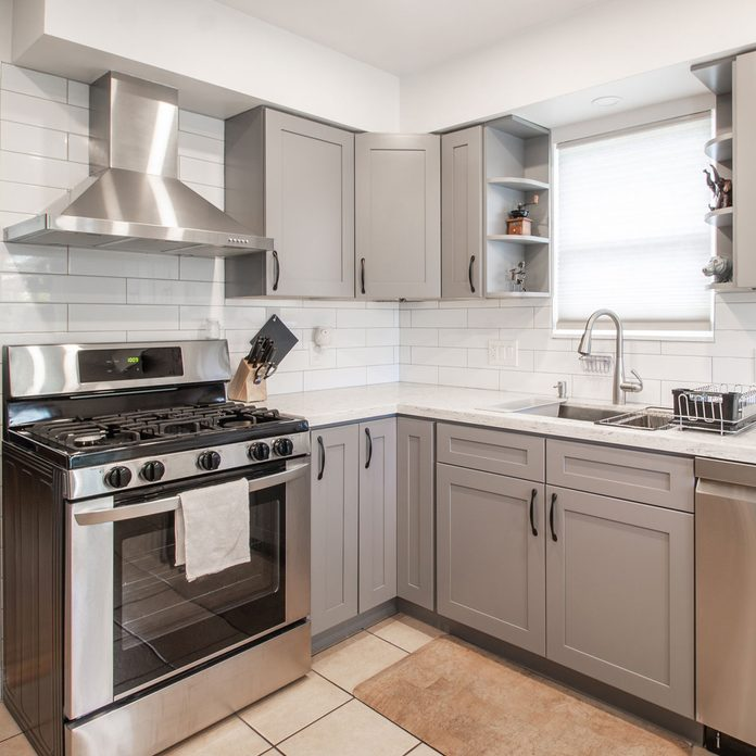 Cohesive kitchen with gray cabinets and white walls