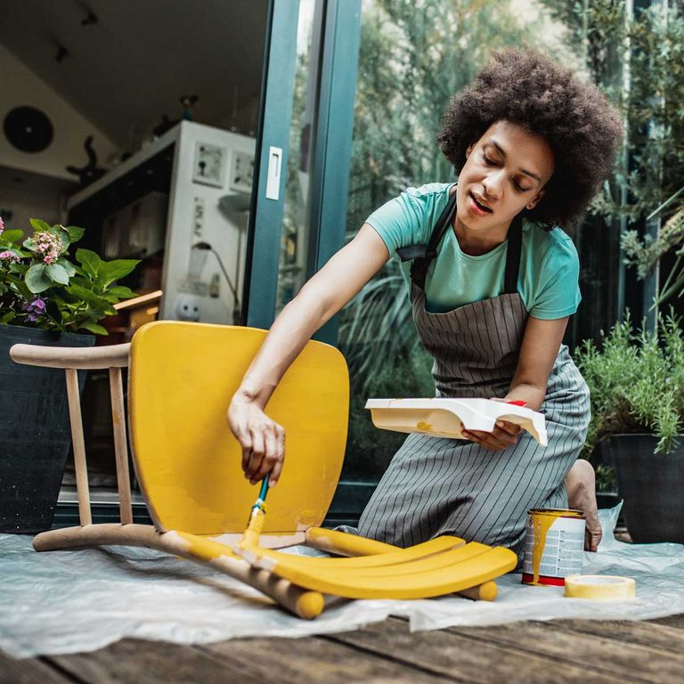 Woman Painting A Chair Gettyimages 1255615576